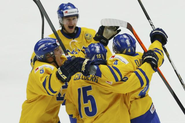 Sweden's Christian Djoos (R) celebrates his goal against Finland with his teammates during the third period of their IIHF World Junior Championship gold medal ice hockey game in Malmo, Sweden, January 5, 2014. REUTERS/Alexander Demianchuk (SWEDEN - Tags: SPORT ICE HOCKEY)