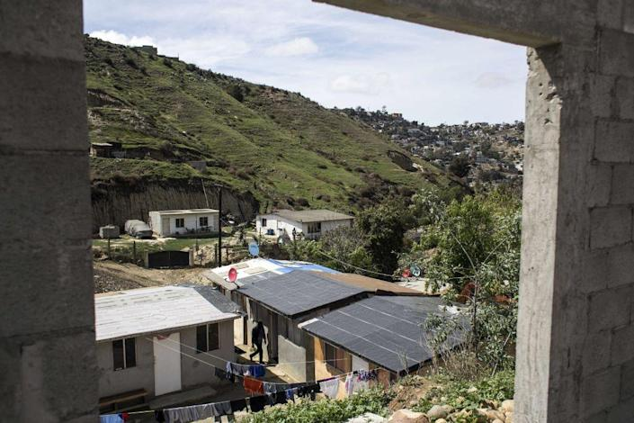 """View of """"Little Haiti,"""" a neighborhood of some 40 houses, built for refugee families near the Embajadores de Jesus church, in the suburbs of Tijuana, Mexico on March 11, 2018.<span class=""""copyright"""">Guillermo Arias—AFP/Getty Images</span>"""