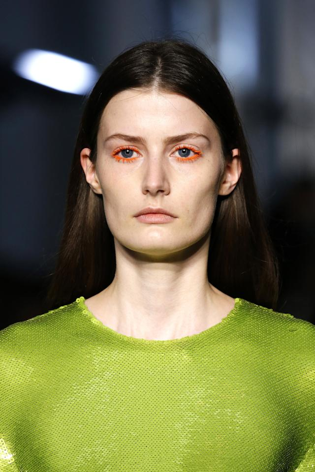 <p>Brightly colored mascara in shades of orange, white, green and lavender were the focus at Emilio Pucci.</p>