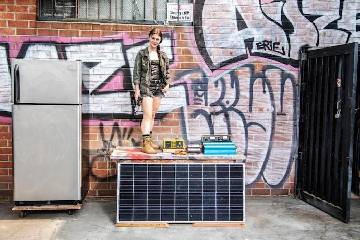 LOS ANGELES, CA - SEPTEMBER 14: Bee Burlingame poses for a portrait beside all the materials she will use to create LA's first solar community fridge outside her workspace on Monday, Sept. 14, 2020 in Los Angeles, CA. (Mariah Tauger / Los Angeles Times)