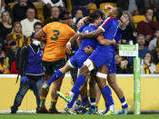 France's Baptiste Couilloud, centre, is congratulated by teammates after scoring a try during the third rugby international between France and Australia at Suncorp Stadium in Brisbane, Australia, Saturday, July 17, 2021. (AP Photo/Tertius Pickard)