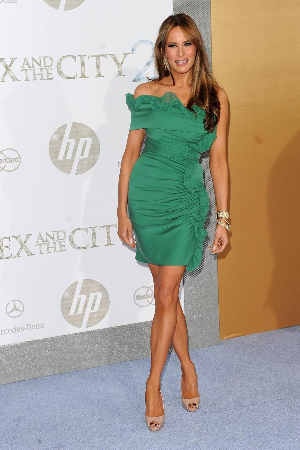 <p>Melania arrived at the <i>Sex and the City 2</i> premiere in a short ruffled green ensemble. <i>[Photo: Getty]</i> </p>