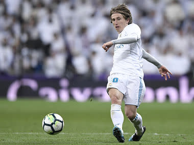 Real Madrid's Croatian midfielder Luka Modric runs with the ball during the Spanish league football match between Real Madrid CF and Real Sociedad at the Santiago Bernabeu stadium in Madrid on February 10, 2018. / AFP PHOTO / GABRIEL BOUYS