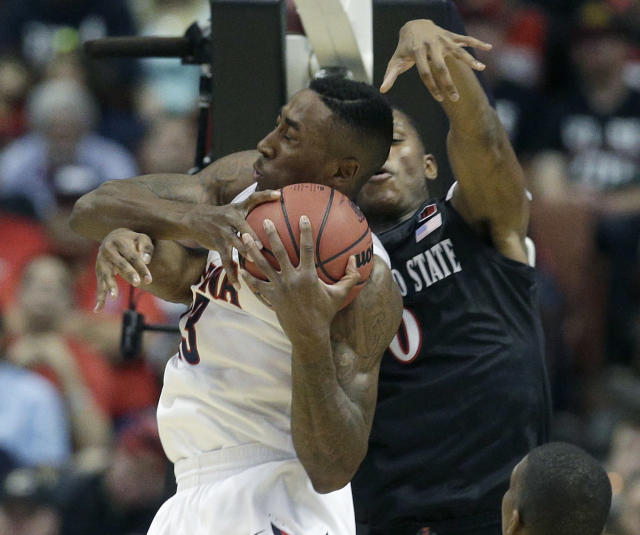 Arizona forward Rondae Hollis-Jefferson, left, competes with San Diego State forward Skylar Spencer for a rebound during the first half of an NCAA men's college basketball tournament regional semifinal, Thursday, March 27, 2014, in Anaheim, Calif. (AP Photo/Jae C. Hong)