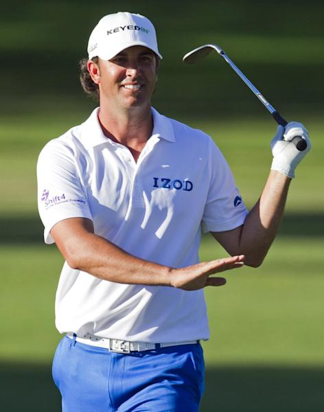 Scott Piercy reacts to his putt on the eighth green during the second round of the Sony Open golf tournament on Friday, Jan. 11, 2013, in Honolulu. (AP Photo/Marco Garcia)