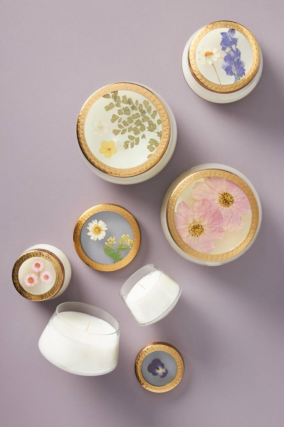"<p><strong>Rosy Rings Anthropologie</strong></p><p>anthropologie.com</p><p><strong>$26.00</strong></p><p><a href=""https://go.redirectingat.com?id=74968X1596630&url=https%3A%2F%2Fwww.anthropologie.com%2Fshop%2Ffloral-press-candle&sref=https%3A%2F%2Fwww.goodhousekeeping.com%2Fholidays%2Fgift-ideas%2Fg34386830%2Fanthropologie-holiday-collection-2020%2F"" rel=""nofollow noopener"" target=""_blank"" data-ylk=""slk:Shop Now"" class=""link rapid-noclick-resp"">Shop Now</a></p>"