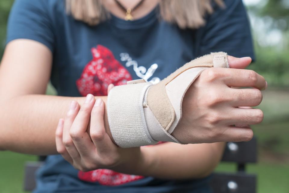 Woman with cast on wrist, changes over 40
