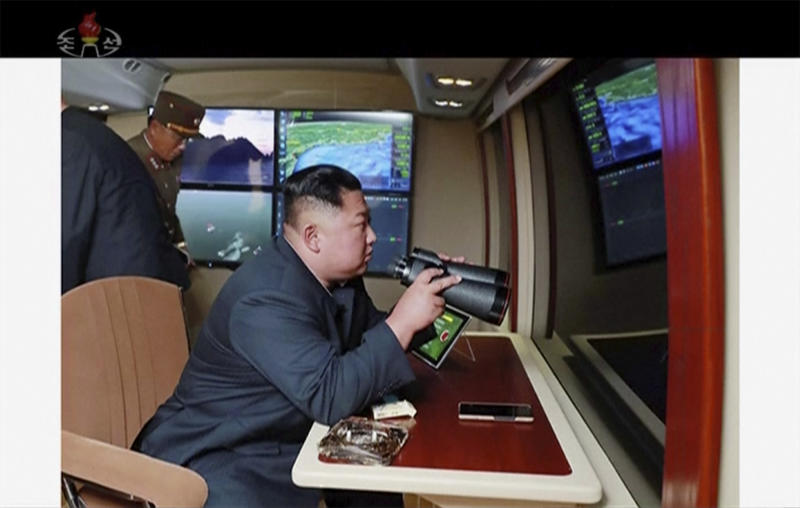 In this image made from video of a still image broadcasted by North Korea's KRT on Thursday, Aug. 1, 2019, North Korean leader Kim Jong Un, equipped with binoculars, supervises a rocket launch test. North Korea said Thursday, Aug. 1, leader Kim supervised the first test firing of a new multiple rocket launcher system that could potentially enhance its ability to strike targets in South Korea and U.S. military bases there.(KRT via AP Video)