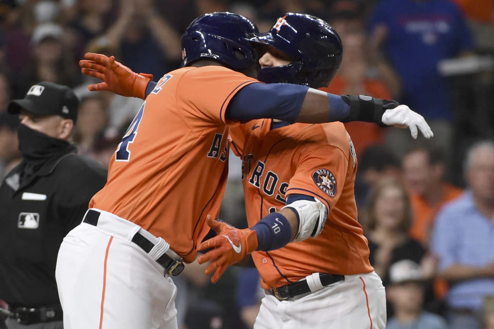 Houston Astros' Yuli Gurriel, right, celebrates his two-run home run with Yordan Alvarez during the fifth inning of baseball game against the Toronto Blue Jays, Friday, May 7, 2021, in Houston. (AP Photo/Eric Christian Smith)