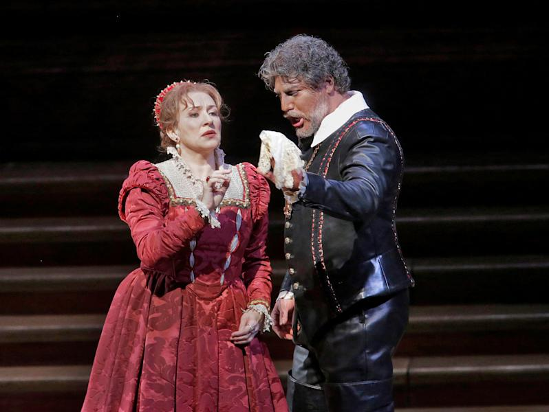"""In this March 11, 2013 photo provided by the Metropolitan Opera, Krassimira Stoyanova is in the role of Desdemona opposite Jose Cura in the title role during a performance of of Verdi's """"Otello,"""" at the Metropolitan Opera in New York. (AP Photo/Ken Howard)"""