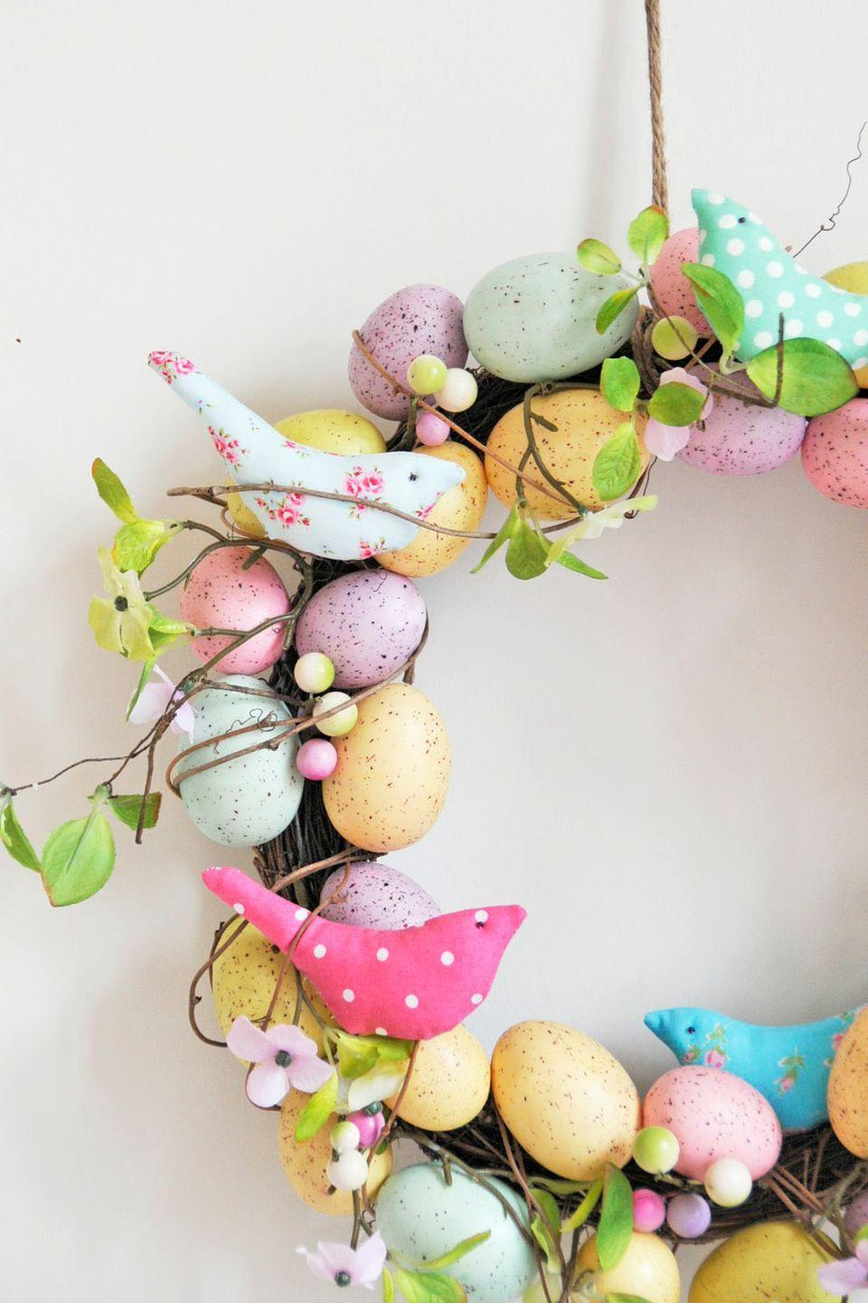 """<p>Colorful fabric birds and speckled eggs adorn this whimsical wreath for Easter.</p><p><strong>Get the tutorial at <a href=""""http://helenphilipps.blogspot.com/2013/03/easter-decorating.html"""" rel=""""nofollow noopener"""" target=""""_blank"""" data-ylk=""""slk:Helen Philipps"""" class=""""link rapid-noclick-resp"""">Helen Philipps</a>.</strong></p><p><strong><a class=""""link rapid-noclick-resp"""" href=""""https://www.amazon.com/Misscrafts-Squares-Patchwork-Scrapbooking-Quilting/dp/B01MS22AJV?tag=syn-yahoo-20&ascsubtag=%5Bartid%7C10050.g.4088%5Bsrc%7Cyahoo-us"""" rel=""""nofollow noopener"""" target=""""_blank"""" data-ylk=""""slk:SHOP SPRING FABRIC"""">SHOP SPRING FABRIC</a></strong></p>"""