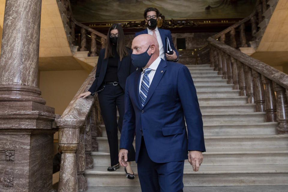 Sen. Mark Kelly, D-Ariz., arrives to deliver his maiden speech to the Senate, at the Capitol in Washington, Wednesday, Aug. 4, 2021. (AP Photo/Amanda Andrade-Rhoades)