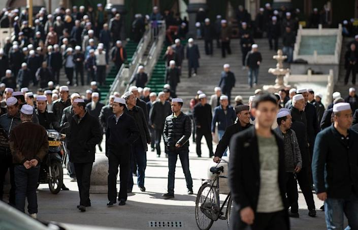 Ethnic Hui Muslims leaving Laohuasi Mosque after Friday prayers in Linxia, China's Gansu province, where many fear fear a deliberate campaign to 'exterminate' Islam is under way (AFP Photo/Johannes EISELE)
