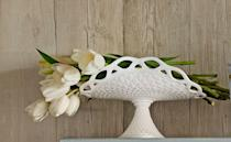 <p>Victorians wanted a dish for everything; bananas were no exception. This 1950s reproduction, used here as a flower display, features a lace edge and holds a value of $45. </p><p><strong>What it's worth:</strong> One from the early 1900s could fetch up to $100.</p>