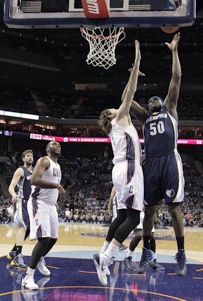 Memphis Grizzlies' Zach Randolph (50) shoots over Charlotte Bobcats' Josh McRoberts (11) during the first half of an NBA basketball game in Charlotte, N.C., Saturday, Feb. 22, 2014. Charlotte's Al Jefferson and Memphis' Marc Gasol watch from the left. (AP Photo/Bob Leverone)