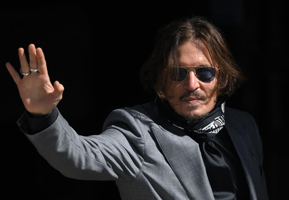 """LONDON, ENGLAND - JULY 28: Johnny Depp arrives at the Royal Courts of Justice, the Strand on July 28, 2020 in London, England. The Hollywood Actor is suing News Group Newspapers (NGN) and the Sun's executive editor, Dan Wootton, over an article published in 2018 that referred to him as a """"wife beater"""" during his marriage to actor Amber Heard. (Photo by Karwai Tang/WireImage)"""
