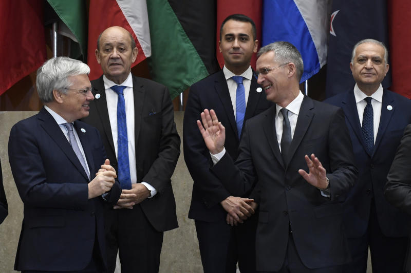 NATO Secretary General Jens Stoltenberg, second from right, talks with Belgium's Deputy Prime Minister and Minister of Foreign Affairs and Defense Didier Reynders, left, as they and other foreign ministers and officials wait to pose for a group photo at the State Department in Washington, Thursday, Nov. 14, 2019, for the Global Coalition to Defeat ISIS Small Group Ministerial meeting. (AP Photo/Susan Walsh)