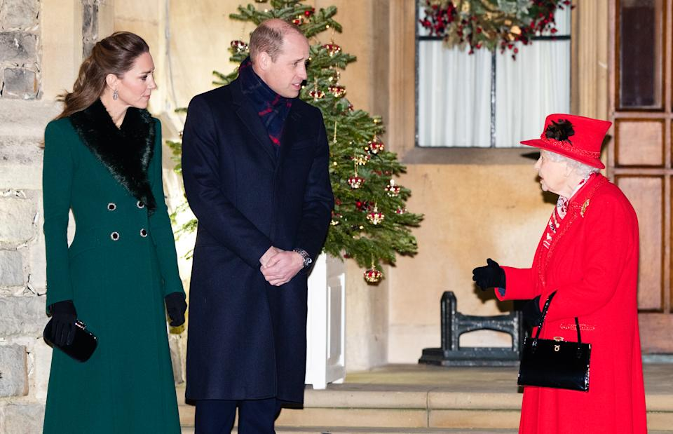 Catherine, Duchess of Cambridge, Prince William, Duke of Cambridge and Queen Elizabeth II wait to thank local volunteers and key workers for the work they are doing during the coronavirus pandemic and over Christmas in the quadrangle of Windsor Castle on December 8, 2020 in Windsor, England