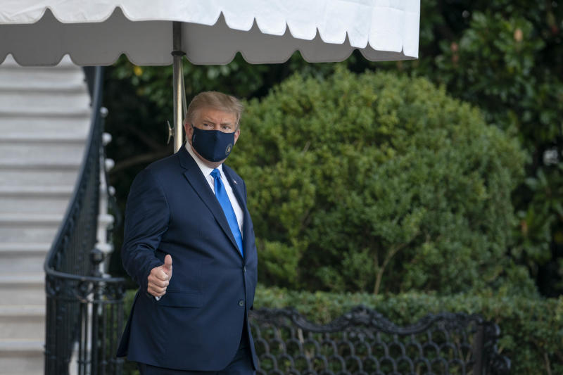 U.S. President Donald Trump walks along the South Lawn of the White House before boarding Marine One in Washington, D.C., U.S., on Friday, Oct. 2, 2020. Trump will be taken to Walter Reed National Military Medical Center to be treated for Covid-19, the White House said. Photographer: Sarah Silbiger/Pool/Sipa USA