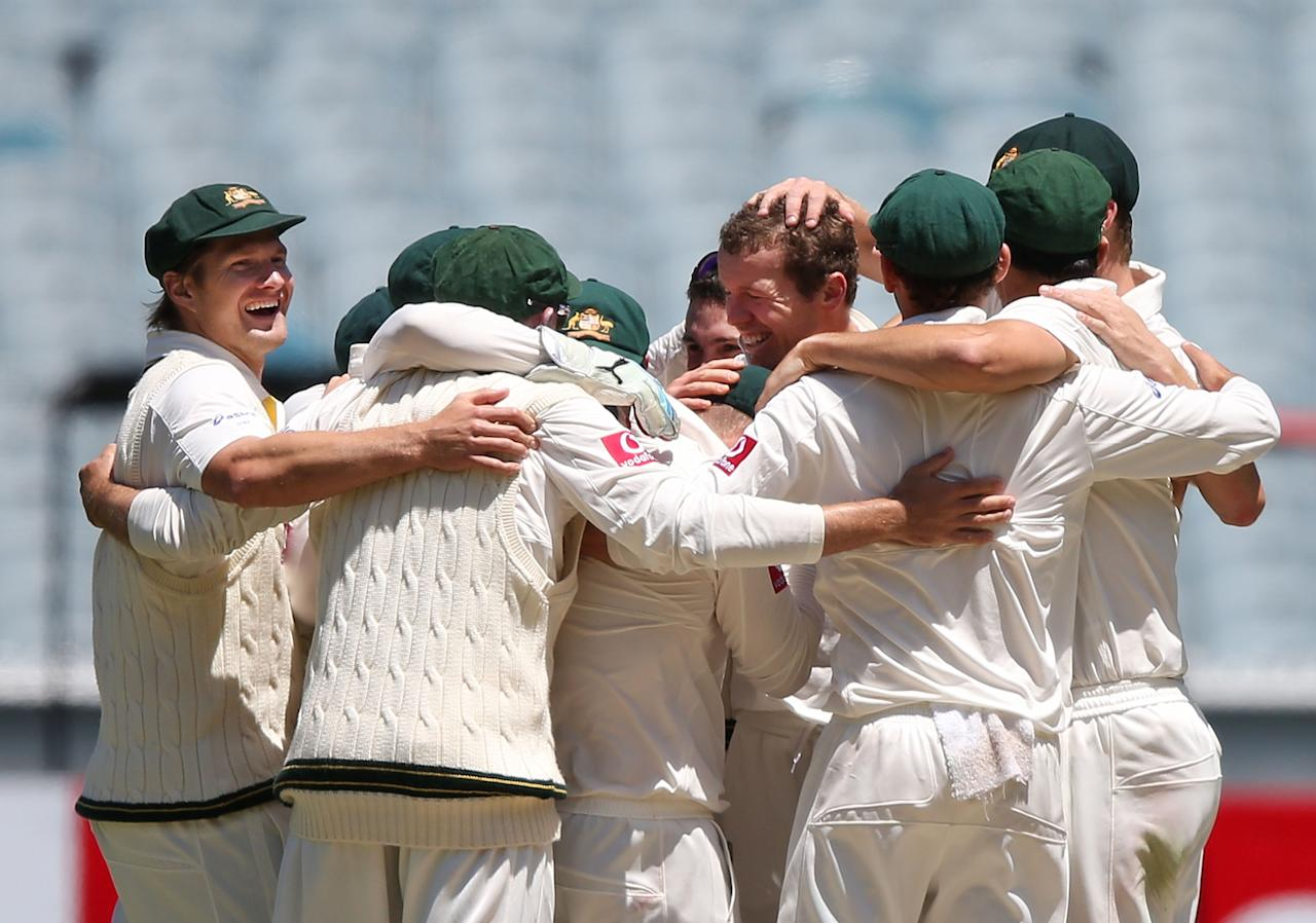 MELBOURNE, AUSTRALIA - DECEMBER 28:  The Australian cricket team celebrate the last wicket to win the match during day three of the Second Test match between Australia and Sri Lanka at Melbourne Cricket Ground on December 28, 2012 in Melbourne, Australia.  (Photo by Michael Dodge/Getty Images)