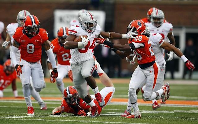 Ohio State running back Carlos Hyde (34) stiff arms Illinois defensive back Jaylen Dunlap (28) as he runs 51-yards for a touchdown during the second half of an NCAA college football game on Saturday, Nov. 16, 2013, in Champaign, Ill. Ohio State won the game 60-35. (AP Photo/Jeff Haynes)