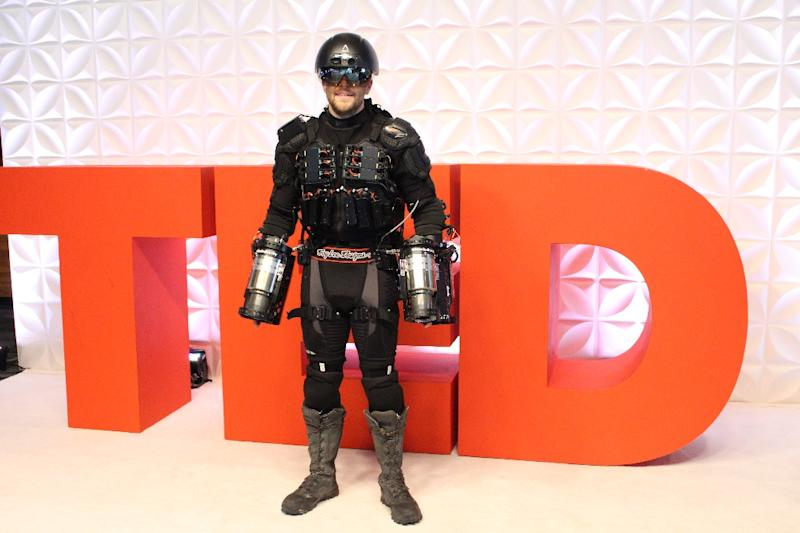 Richard Browning attends the TED Conference in his personal flight suit in Vancouver, Canada, on April 27, 2017 (AFP Photo/Glenn CHAPMAN)