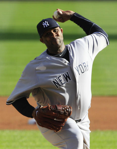 New York Yankees' CC Sabathia throws in the first inning during Game 4 of the American League championship series against the Detroit Tigers Thursday, Oct. 18, 2012, in Detroit. (AP Photo/Carlos Osorio)