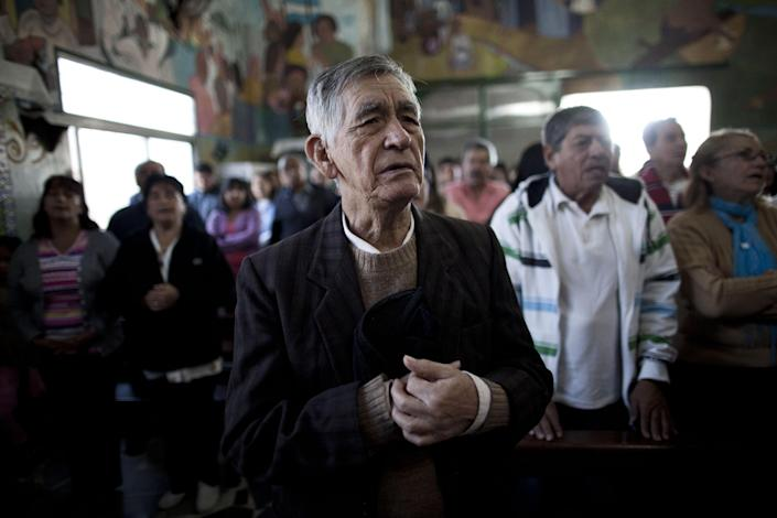 Teodoro Maldonado attends Mass in the Villa 21-24 slum in Buenos Aires, Argentina, Sunday, March 17, 2013. Villa 21-24 is a slum so dangerous that most outsiders don't dare enter, but residents say Jorge Mario Bergoglio often showed up unannounced to share laughs and sips of mate, the traditional Argentine herbal tea shared by groups using a common straw. Bergoglio was chosen as leader of the Catholic Church on March 13, 2013, and chose the name Francis. (AP Photo/Natacha Pisarenko)