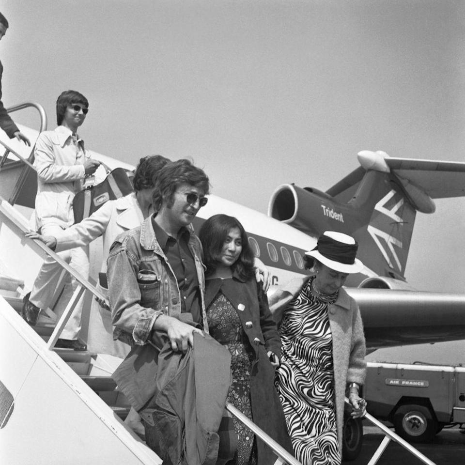 <p>John Lennon and Yoko Ono disembark from a small plane in 1971 as they arrive in France for the Cannes Film Festival, shortly after Lennon announced his departure from The Beatles. </p>