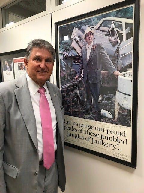 """Sen. Joe Manchin, D-W.Va., has a framed poster in his Capitol Hill office of his flamboyant uncle A. James """"Jimmy"""" Manchin, who served as West Virginia secretary of state and helped inspire young Joe to pursue public service."""