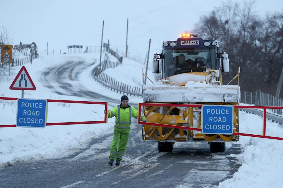 The snow gates on the A93 at Spittal of Glenshee are opened and closed to allow a snow cutting vehicle to pass through . (PA)