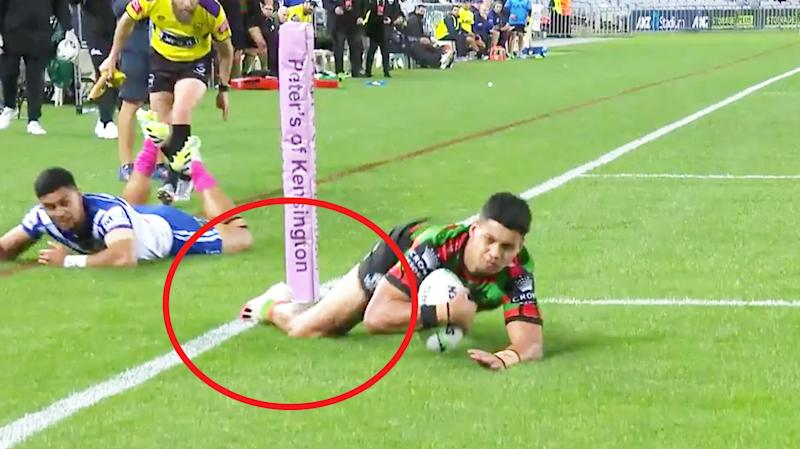 Rabbitohs winger Jaxson Paulo's right foot appeared to touch in goal before he grounded the ball. (Image: Fox Sports)