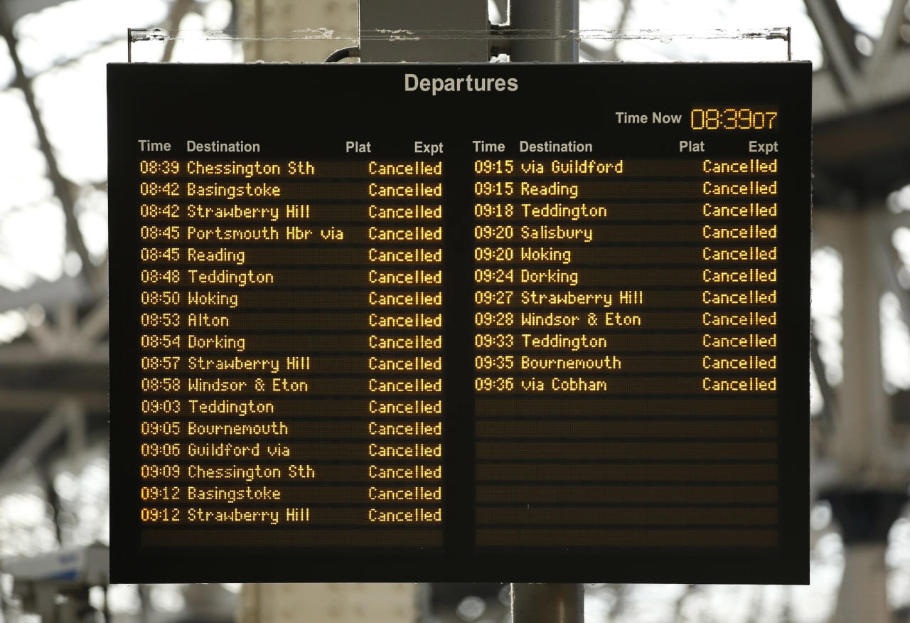 A departure board at Waterloo Station flash the cancellations of train service in London, Monday Oct. 28, 2013. Express train services between central London and Gatwick and Stansted airports were suspended because of the storm, and the major English port of Dover was closed, leading to a cutoff in ferry service to France. (AP Photo/PA, Jonathan Brady) UNITED KINGDOM OUT, NO SALES, NO ARCHIVES