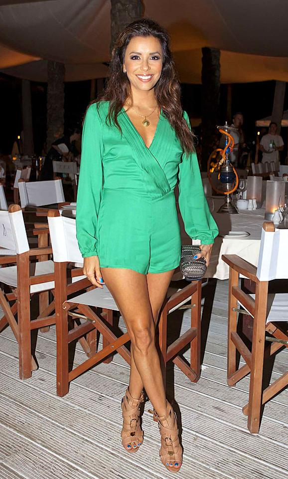 "OK, we can admit that Eva Longoria's hair is looking a little lackluster in this picture, but we'll forgive her follicles and simply focus on the amazing, emerald-green Pixie Market romper and nude Brian Atwood sandals she wore to dinner while vacationing in Spain. (8/17/2012)<br><br><a target=""_blank"" href=""http://omg.yahoo.com/news/eva-longoria-settles-car-accident-lawsuit-003200758.html"">Longoria settles car accident lawsuit</a>"