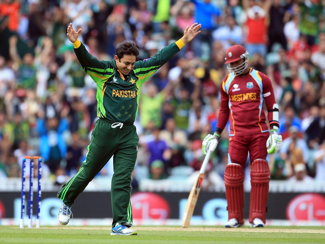 LONDON, ENGLAND - JUNE 07:  Saeed Ajmal of Pakistan celebrates taking the wicket of Chris Gayle of West Indies during the ICC Champions Trophy group B match between West Indies and Pakistan at The Oval on June 7, 2013 in London, England.  (Photo by Richard Heathcote/Getty Images)
