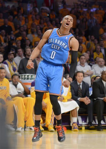 Oklahoma City Thunder guard Russell Westbrook celebrates after dunking during the second half in Game 3 of an NBA basketball playoffs Western Conference semifinal against the Los Angeles Lakers, Friday, May 18, 2012, in Los Angeles. The Lakers won 99-96. (AP Photo/Mark J. Terrill)