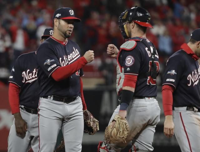Washington Nationals starting pitcher Anibal Sanchez is congratulated by catcher Yan Gomes after being taken out of the game during the eighth inning of Game 1 of the baseball National League Championship Series Friday, Oct. 11, 2019, in St. Louis. (AP Photo/Mark Humphrey)