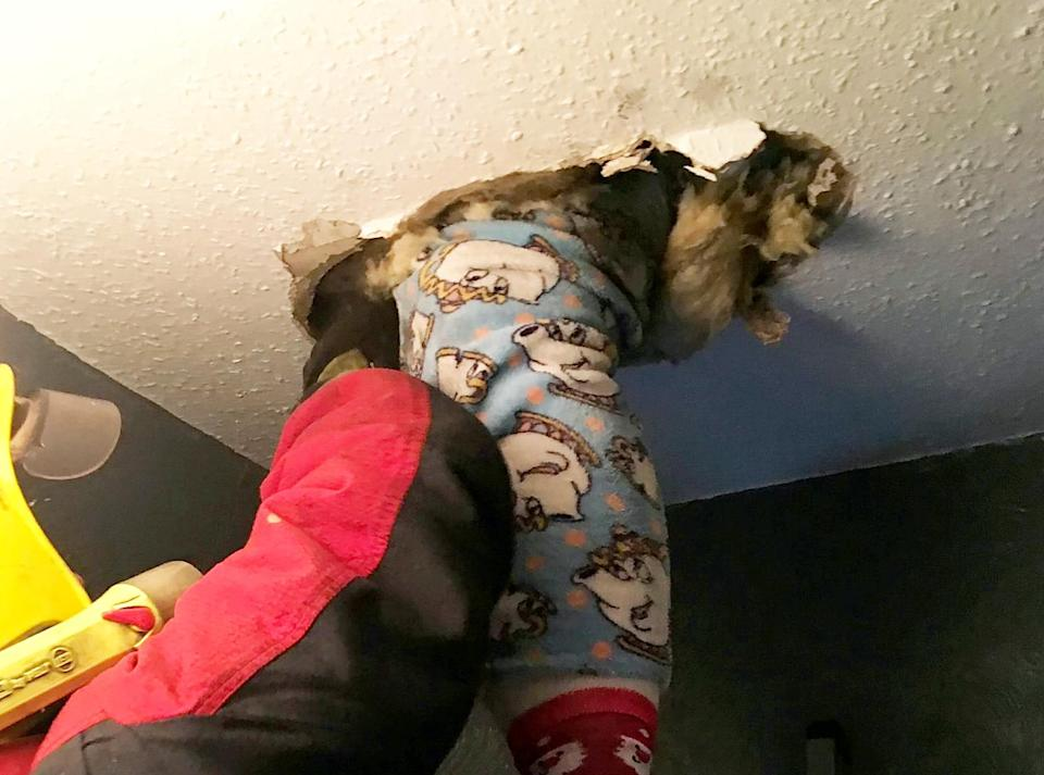 <em>Claus-trophobic – Stacielea Doran had to be rescued by firefighters after falling through her ceiling – in her Beauty and the Beat onesie (Picture: SWNS)</em>