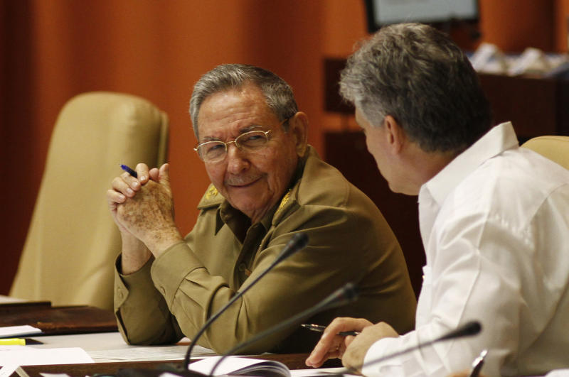 Cuba's President Raul Castro, left, and Vice President Miguel Diaz-Canel talk during the second day of a twice-annual legislative sessions, at the National Assembly in Havana, Cuba, Sunday, July 7, 2013. Observers will be watching to see if the new vice president is taking on increasing responsibility since assuming the post in what was seen as the beginning of a generational leadership transition. (AP Photo/Ismael Francisco, Cubadebate)