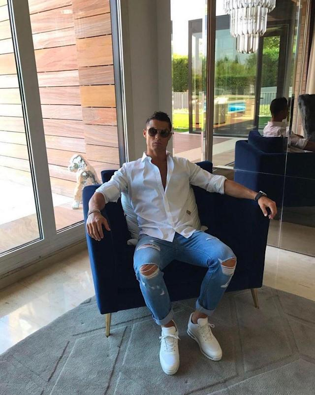 The sun lounge: Ronaldo relaxes in one of his thrones