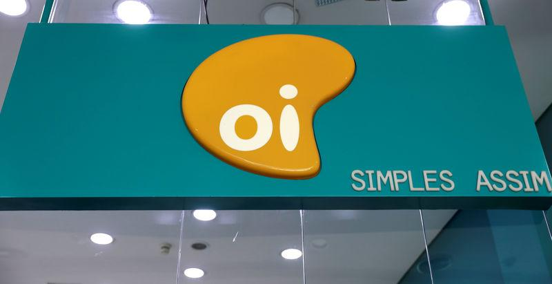 FILE PHOTO: The logo of Brazilian telecoms company Oi SA is pictured inside a store in Sao Paulo, Brazil July 18, 2018. REUTERS/Paulo Whitaker/File photo