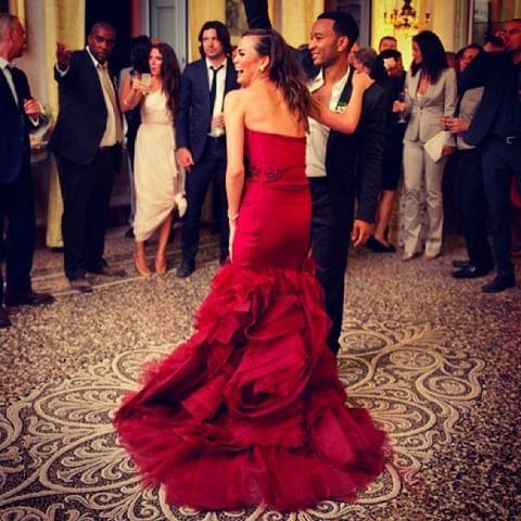 "<p>Chrissy wore a total of three Vera Wang gowns during her wedding ceremony to John Legend. She changed in to a romantic deep red number for the reception with ruffle fishtail train. </p><p><a href=""https://www.instagram.com/p/e_fSczpjYh/?hl=en-gb"" rel=""nofollow noopener"" target=""_blank"" data-ylk=""slk:See the original post on Instagram"" class=""link rapid-noclick-resp"">See the original post on Instagram</a></p>"