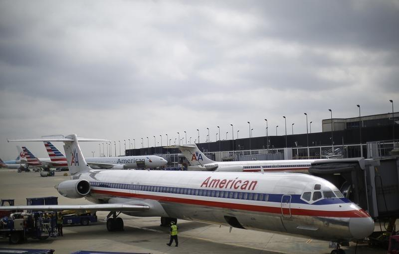 An American Airlines airplane sits at a gate at the O'Hare Airport in Chicago, Illinois