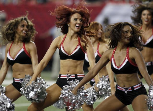 Atlanta Falcons cheerleaders perform in the second half of their NFL football game against the St. Louis Rams in Atlanta, Georgia September 15, 2013. REUTERS/Tami Chappell (UNITED STATES - Tags: SPORT FOOTBALL)