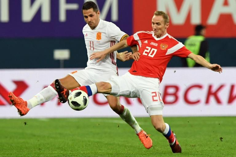 Spain's Vitolo (L) and Russia's Vladislav Ignatyev vie for the ball during an international friendly football match November 14, 2017