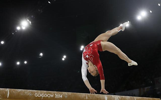 Elsabeth Black of Canada performs her routine during the women's individual beam final at the Commonwealth Games Glasgow 2014, in Glasgow, Scotland, Friday, Aug., 1, 2014. Black won the gold medal. (AP Photo/Alastair Grant)