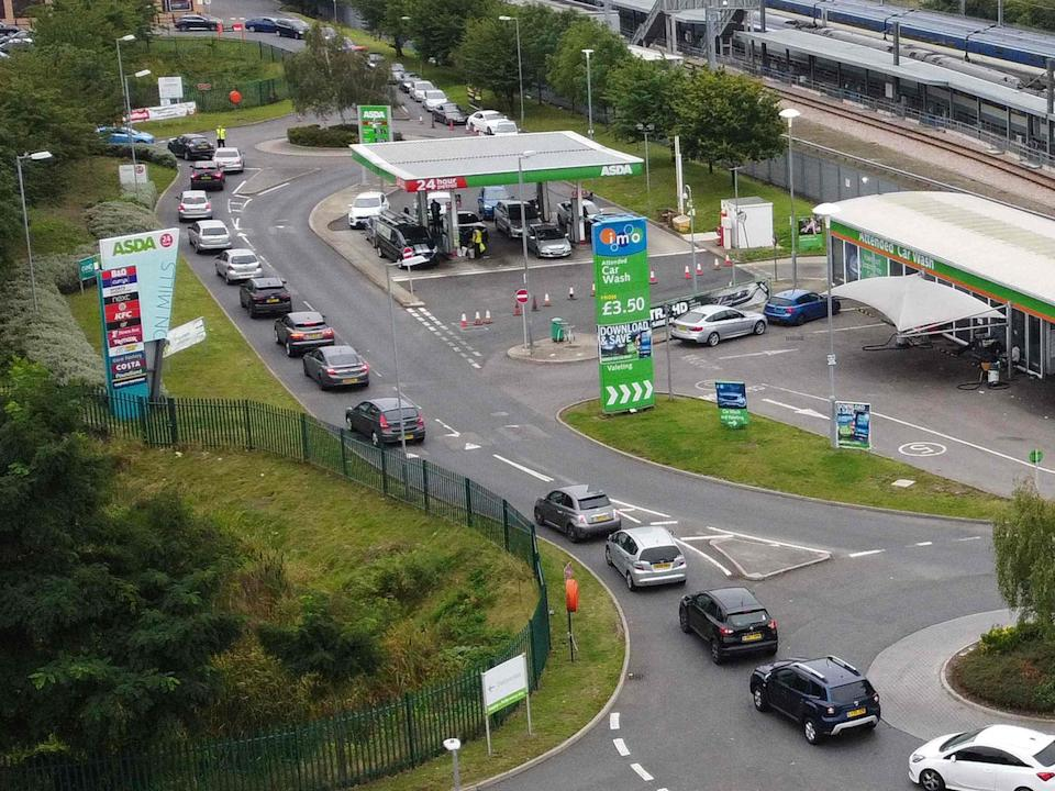 An aerial view shows customers queueing in their cars to access an Asda petrol station in east London (AFP via Getty Images)