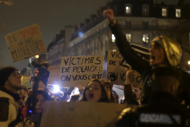 Women protest near the venue of the Cesar awards ceremony, the French equivalent of the Oscars (Credit: AP Photo/Rafael Yaghobzadeh)
