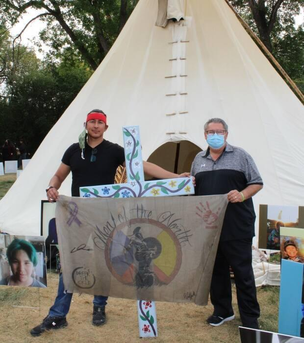 Chris Merasty (left) and Doyle Vermette stand at the Walking With Our Angels camp in Regina last year. The camp was meant to call attention to suicide in Saskatchewan.