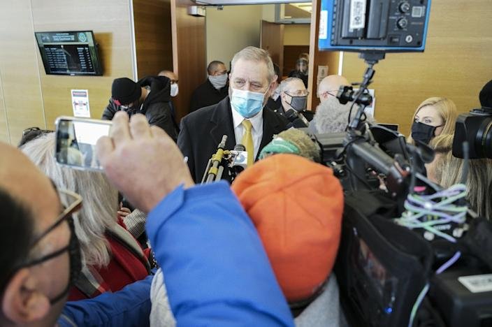Ohio Attorney General Dave Yost speaks with members of the media following the initial appearance of former Columbus police officer Adam Coy on Friday, Feb. 5, 2021 at the Franklin County Common Pleas Courthouse in Columbus, Ohio. Coy was arraigned on four charges in the December 2020 police shooting death of Andre Hill, a Black man. Coy was charged with one count of murder, one count of felonious assault and two counts of dereliction of duty, one of which was for failure to render aid to Hill after he was shot. His bond was set at $3 million. Yost's office was appointed special prosecutor in the case.